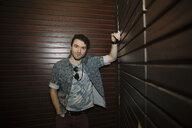 Portrait confident, cool male millennial in nightclub - HEROF14507