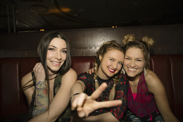 Portrait playful, confident, cool female millennials in nightclub - HEROF14531