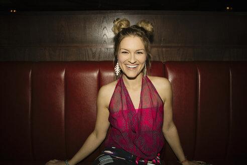 Portrait laughing, carefree, confident female millennial in nightclub - HEROF14534