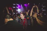 Female millennial laughing, partying and dancing in nightclub - HEROF14780