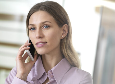 Portait of confident businesswoman on cell phone - ABRF00276