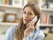 Young woman on cell phone at home - ABRF00288