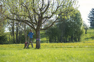 Girl balancing on a slackline in the countryside - SBOF01686