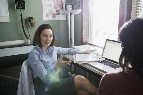 Doctor talking to patient in doctors office - HEROF14857
