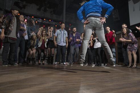 Crowd cheering and watching dancers in nightclub - HEROF14881