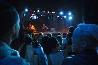 Crowd watching DJ on stage in nightclub - HEROF14890