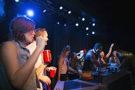 Dancers and DJ on stage in nightclub - HEROF14896
