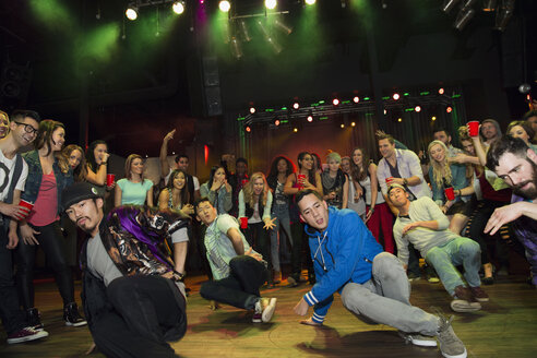 Crowd watching and cheering break dancers - HEROF14926