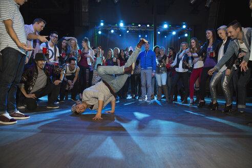 Crowd watching and cheering break dancer - HEROF14929