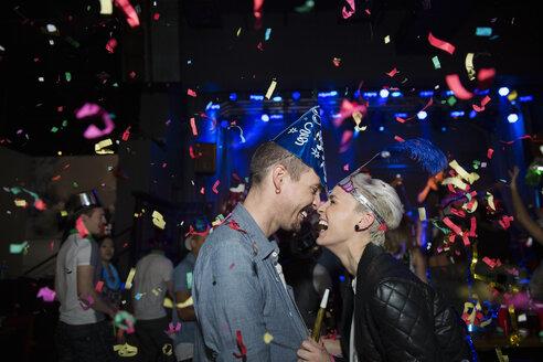 Enthusiastic couple enjoying New Year celebration - HEROF14947