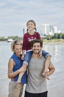 Germany, Duesseldorf, happy family with daughter at Rhine riverbank - RORF01694