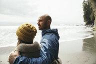 Couple standing on rugged beach - HEROF15278