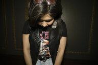 Cool female millennial looking down - HEROF15290