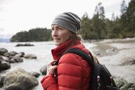 Woman backpacking on rugged beach - HEROF15350