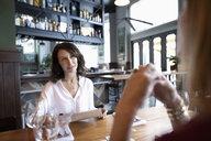 Women friends dining at restaurant - HEROF15410
