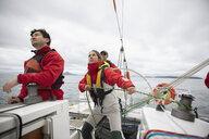 Focused sailing team training on sailboat - HEROF15716