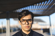 Portrait of fashionable young businessman wearing glasses - AFVF02317