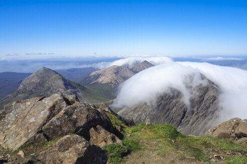 United Kingdom, Scotland, Isle of Skye, View from Bla Bheinn to Cuillin Hills with clouds - HUSF00006