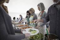 People serving food at soup kitchen community dinner - HEROF15776