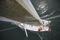 Overhead view sailing team training on sailboat - HEROF15866