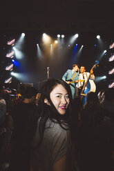 Portrait confident young female millennial enjoying music concert in nightclub - HEROF16052