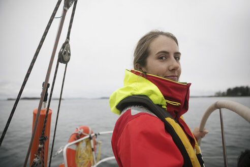 Portrait confident woman steering sailboat on ocean - HEROF16094