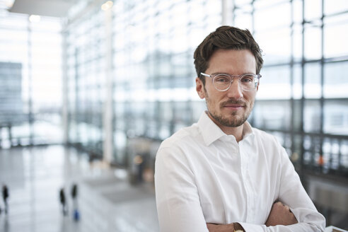 Portrait of confident young businessman wearing glasses - PNEF01242