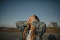 Young woman covering her eyes outdoors - DMGF00031