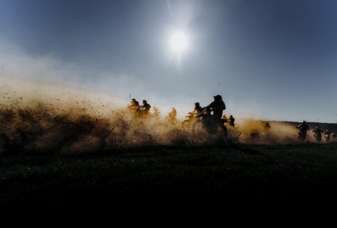 Group of motocross motorcycles coming out in the race. Image taken in Lleida Spain. - OCMF00251