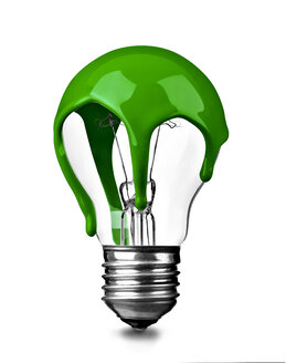 Close up of a green colored light bulb on white background, sustainability concept - RAMF00080
