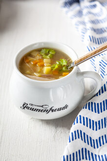 Bowl of homemade chicken stock with potatoes, carrots and parsley - SBDF03888