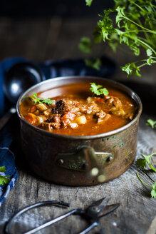 Goulash soup with flat leaf parsley - SBDF03894