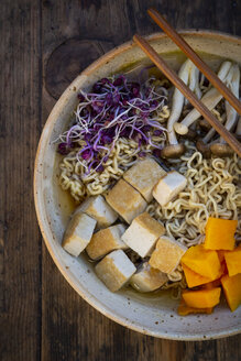 Miso Ramen soup with noodles, red radish sprouts, pumpkin, fried tofu, shimeji and king trumpet mushroom - LVF07756