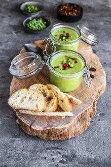 Two glasses of pea soup with fried tofu, red chili pepper and spring onions - SARF04089