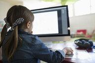 Preschool girl student using computer - HEROF17191
