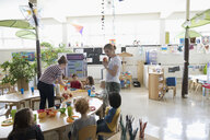 Preschool teacher and students during snack time in classroom - HEROF17242
