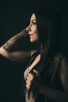Renaissance profile portrait thoughtful, ambitious, forward looking young female millennial with tattoos - HEROF17299