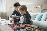 Father and son coloring in living room - HEROF18067
