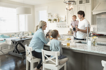 Family eating breakfast at kitchen island - HEROF18175