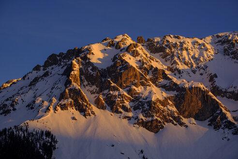 Austria, Styria, Ramsau, View to Dachstein Mountains in winter at sunrise - LBF02353