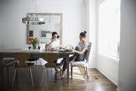 Couple enjoying breakfast at dining table - HEROF18470