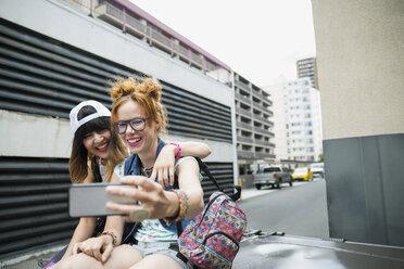 Cool young women taking selfie in urban valley - HEROF18533