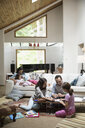 Father coloring with daughters in living room - HEROF18611