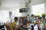Girls eating breakfast at kitchen table - HEROF18695