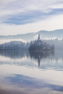 Slovenia, Gorenjska, Bled, Bled lake, Bled island with distinctive Church of Mary's Assumption - FLMF00131