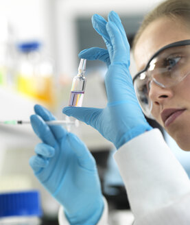 Pharmaceutical Research, Scientist preparing a new drug for testing in the laboratory - ABRF00316