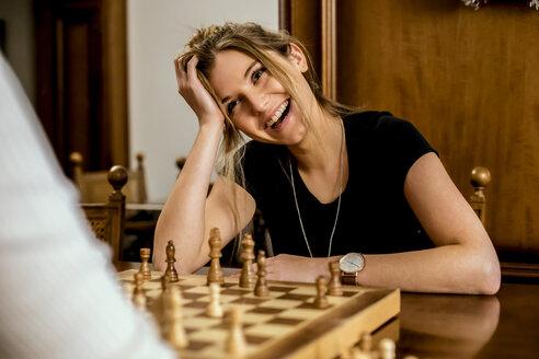 Woman having fun playing chess - ACPF00436