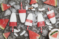 Homemade watermelon coconut ice lollies on crushed ice - GWF05845