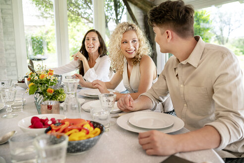 Young man and woman flirting on a family celebration - PESF01272
