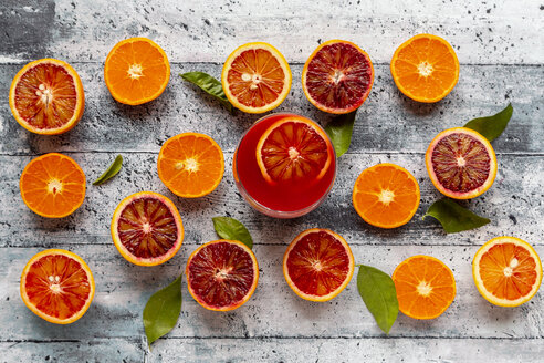 Halves of blood oranges, tangerines and glass of blood orange juice - SARF04096